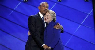 Democratic presidential nominee Hillary Clinton hugs U.S. President Barack Obama as she arrives onstage at the end of his speech on the third night of the 2016 Democratic National Convention in Philadelphia, Pennsylvania, U.S., July 27, 2016.   REUTERS/Jim Young  TPX IMAGES OF THE DAY