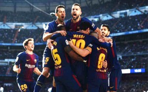 """ศึก El Classico หรือ..Derby Matches..แห่งประเทศสเปน ระหว่าง """"ราชันชุดขาว"""" Real Madrid กับ """"เจ้าบุญทุ่ม"""" Barcelona ..ในวันเสาร์ที่ 23  มีรายงานว่ามีคนดูการแข่งขันคู่นี้ทั่วโลกกว่า 500 ล้านคน เป็นอันดับที่ 2 รองจากทีม  Liverpool พบกับทีม Manchester United ที่มีคนดูทั้งโลกมากถึง 700 ล้านคน นี่ถือเป็นครั้งแรกที่ทั้งคู่โคจรมาปะทะกัน หลังจากมีเหตุการณ์ลงประชามติขอ """"แยกประเทศ"""" จากความประสงค์ของทางฝั่ง..Catalonia...แต่ไม่เป็นผลสำเร็จ """"เจ้าบุญทุ่ม"""" Barcelona โชว์ทีเด็ดบุกไปสยบ """"ราชันชุดขาว"""" Real Madrid  คู่ปรับตลอดกาลถึงถิ่น..Santiago Bernabeu..ราบคาบ 3-0 กระโดดโลดเต้นกอดกันโชว์แสดงความดีใจให้ได้เห็น"""